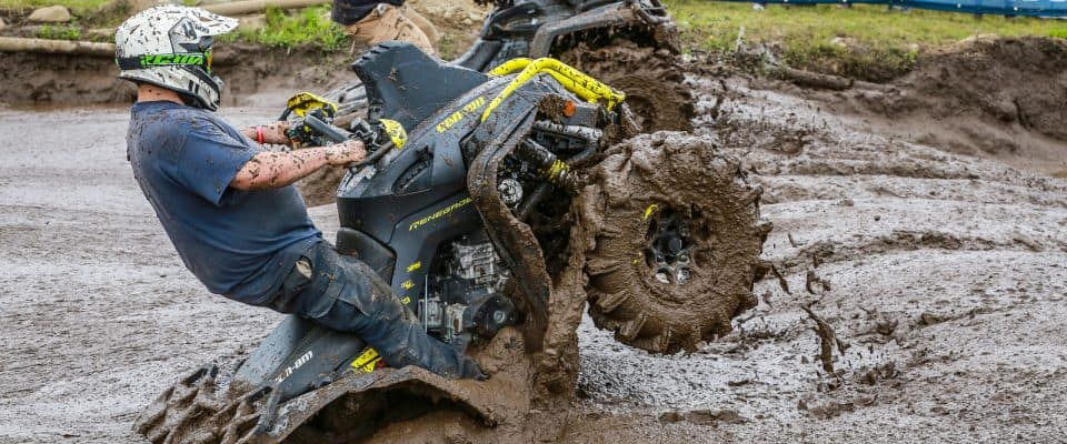 Riders getting dirty in the mudpit at the Jericho ATV Festival